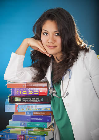 medical-assistant-wearing-scrubs-with-class-books
