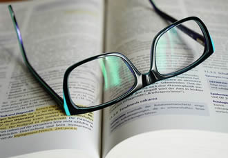 glasses-on-book